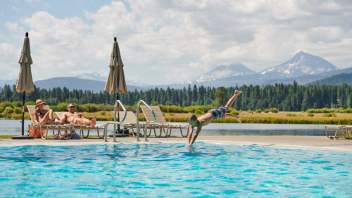 Wading, diving, lap-swimming, sliding and poolside lounging are all encouraged at Black Butte Ranch's top-notch pool facilities, the heart of the resort in the summer months.