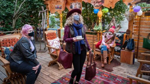 Masked friends enjoy the covered patio of Will Leather Goods.