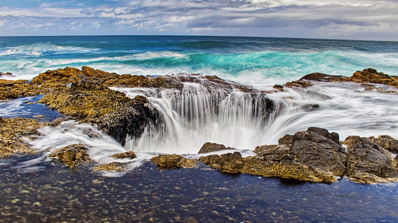 Water rushes into Thors Well near Cape Perpetua.