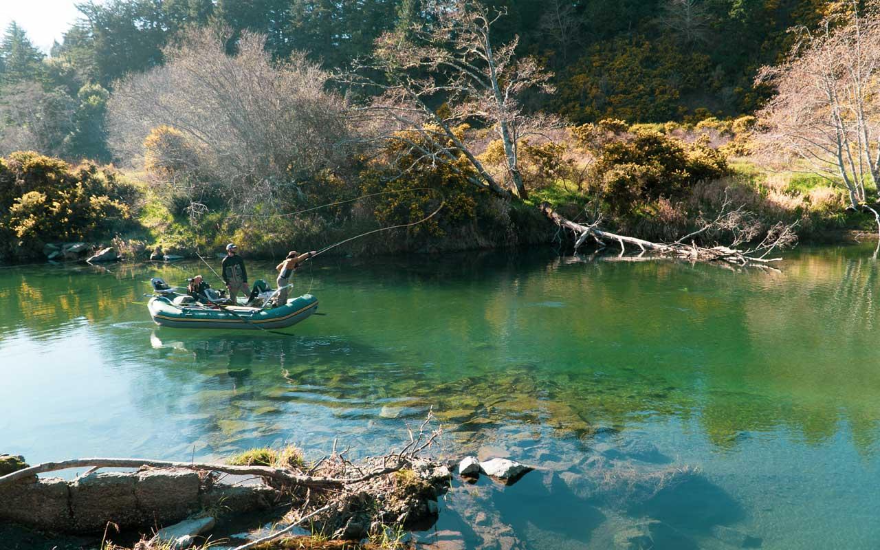 Kayla swings her fishing line from the raft.