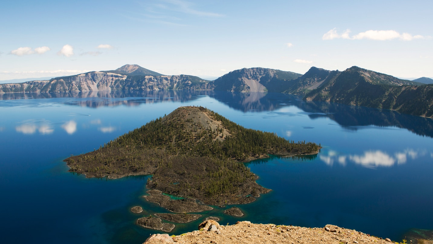 Wizard Island sits in the middle of the massive Crater Lake.