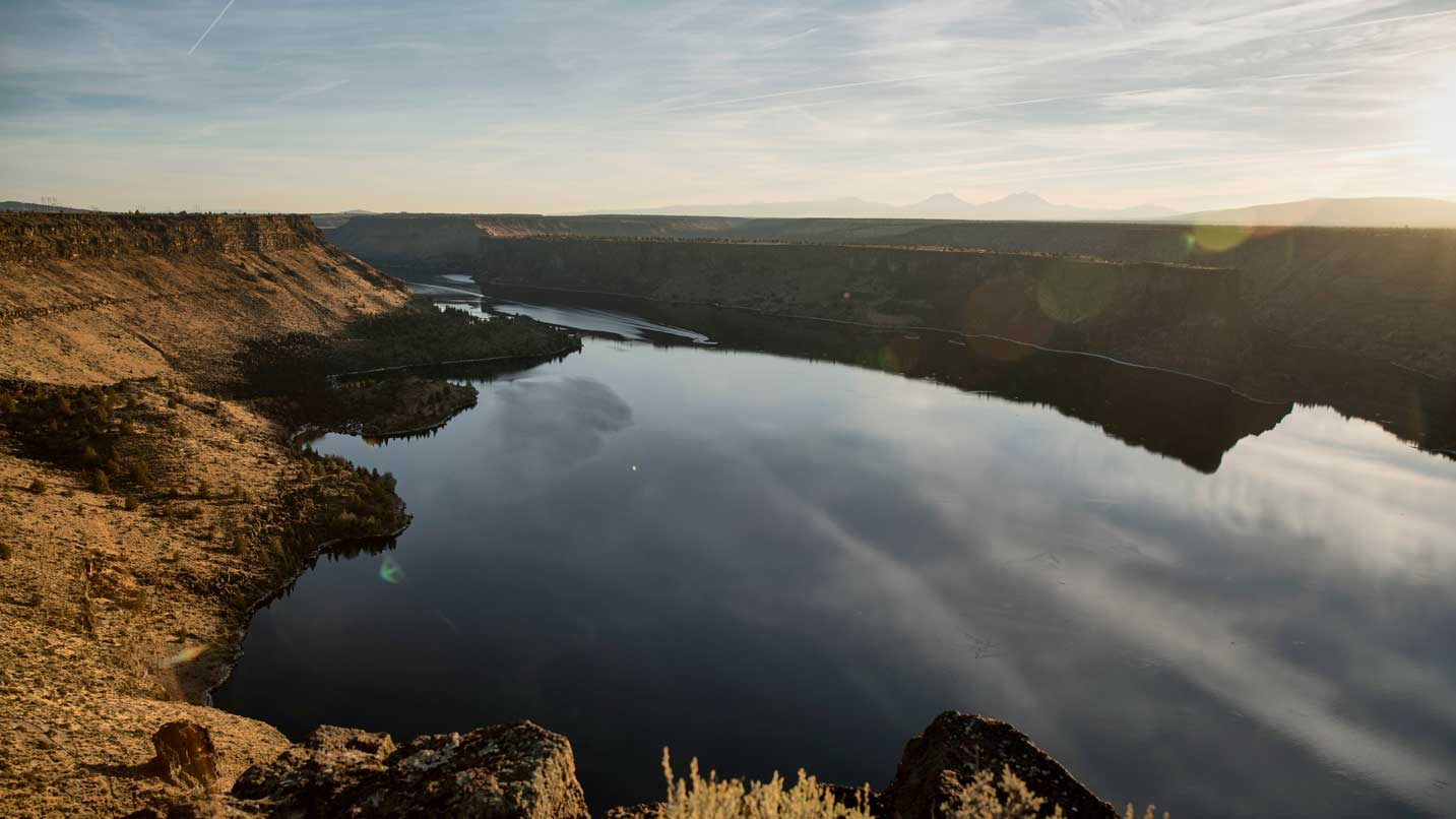 A bird's-eye view of Lake Billy Chinook at sunset.