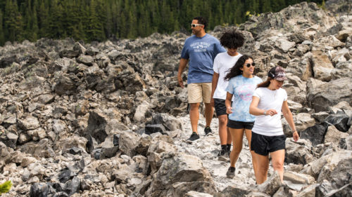 Hikers walk the path at Newberry Crater.