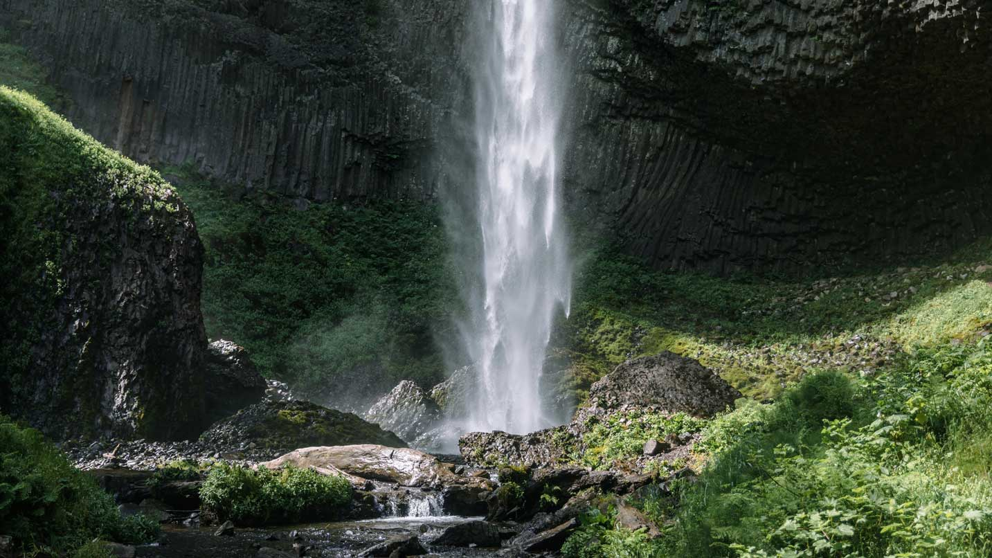 The base of a waterfall in summer.
