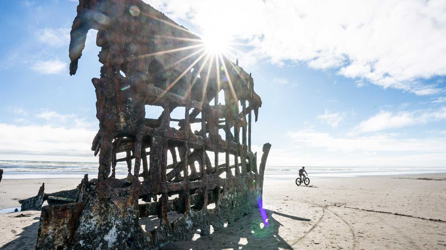 Sun shines through the wreckage of a 1906 ship.