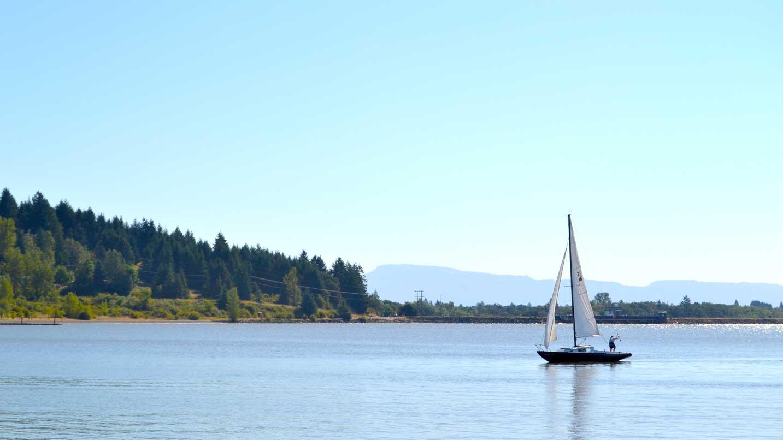 A sailboat floats on Fern Ridge Reservoir outside Eugene.