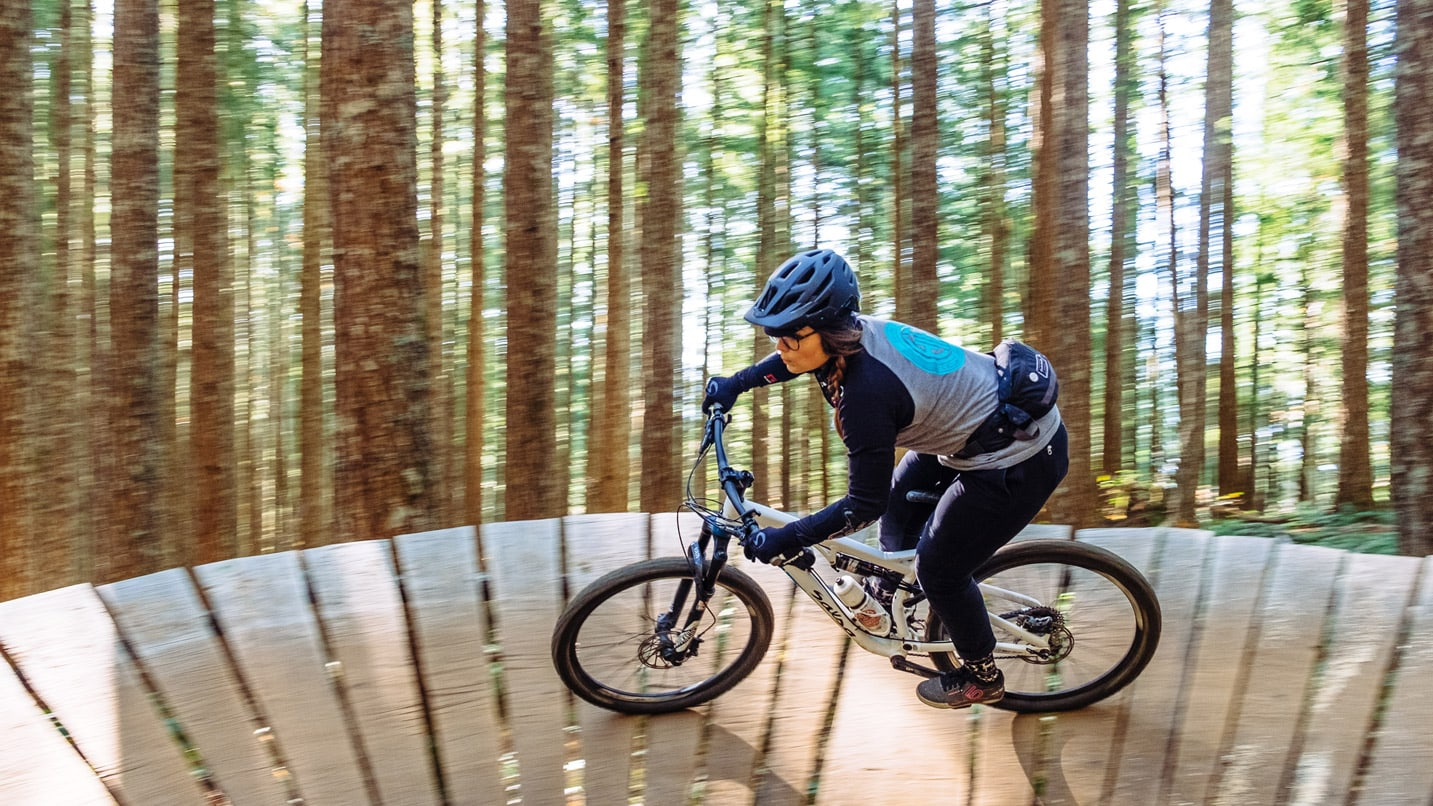 A mountain biker takes a turn on a wooden boardwalk at Black Rock.