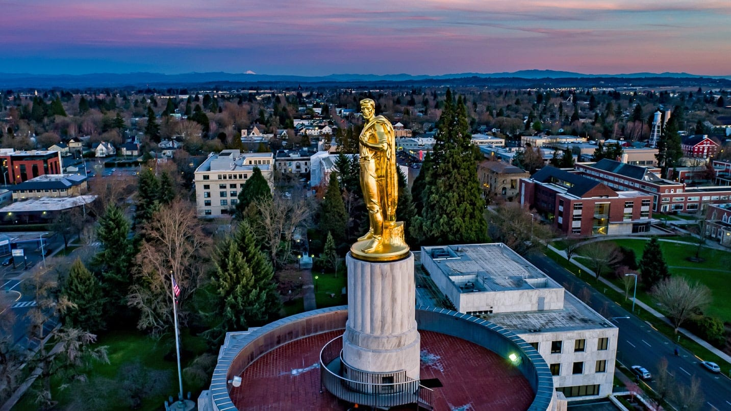 A bird's-eye view of Salem showcases the Oregon Pioneer bronze sculpture atop the Oregon State Capitol.