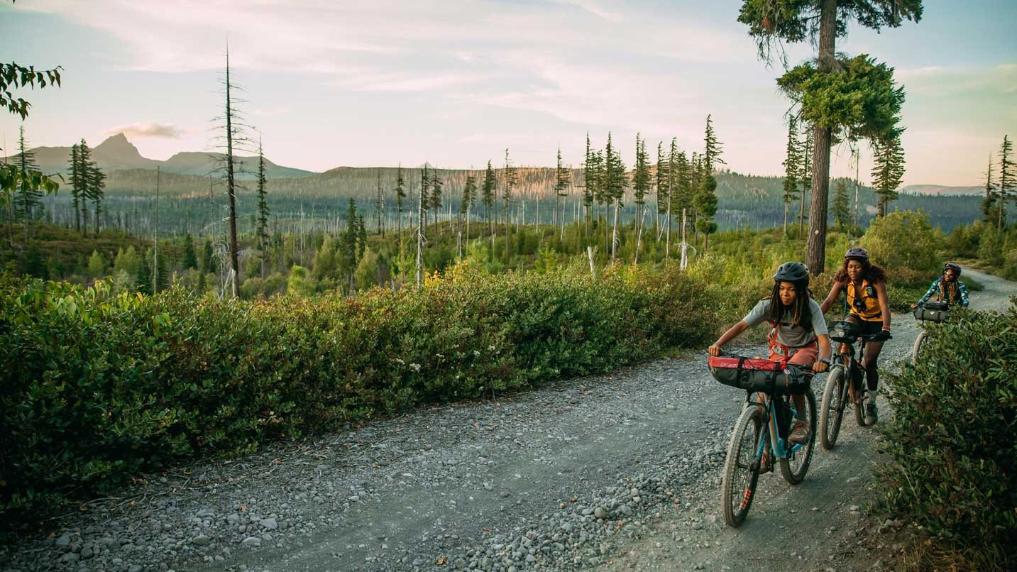 The Central Oregon high desert smells of pine as three bikepackers pedal down a gravel road.