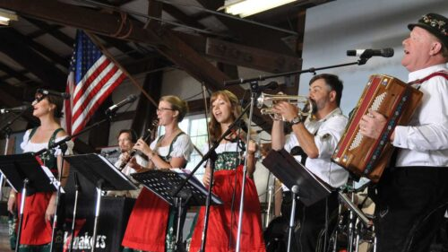 A polka band performs in traditional Bavarian attire.