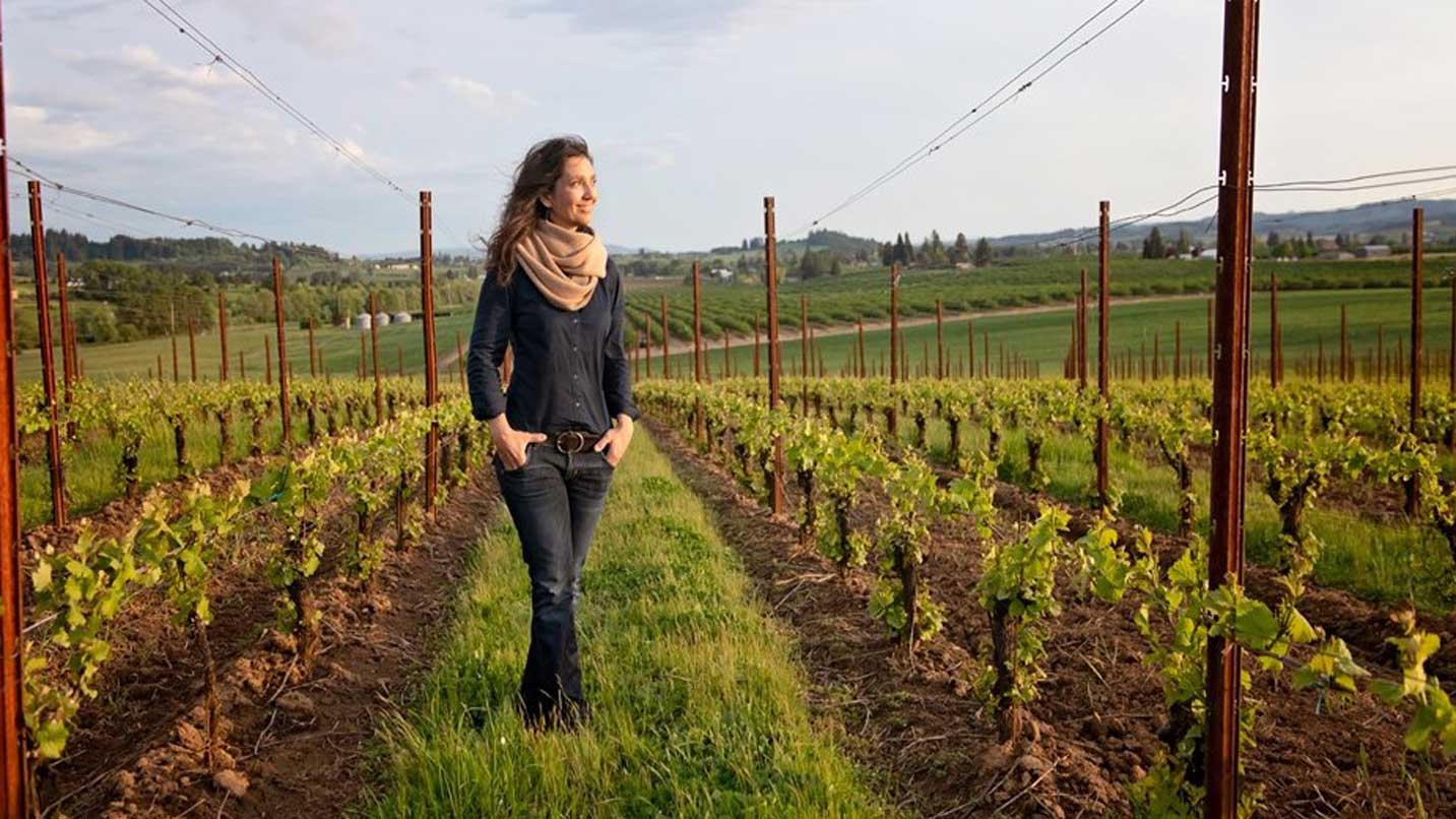 Atticus Wine's Ximena Orrego looks out at her vineyard with a smile.