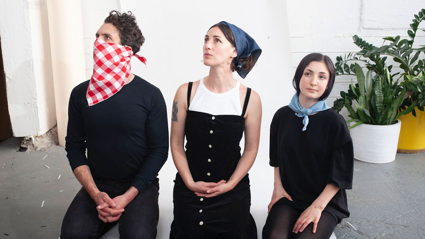 Three people wear the LeMask product, one as a face covering, another as a headscarf and a third as a neck scarf.