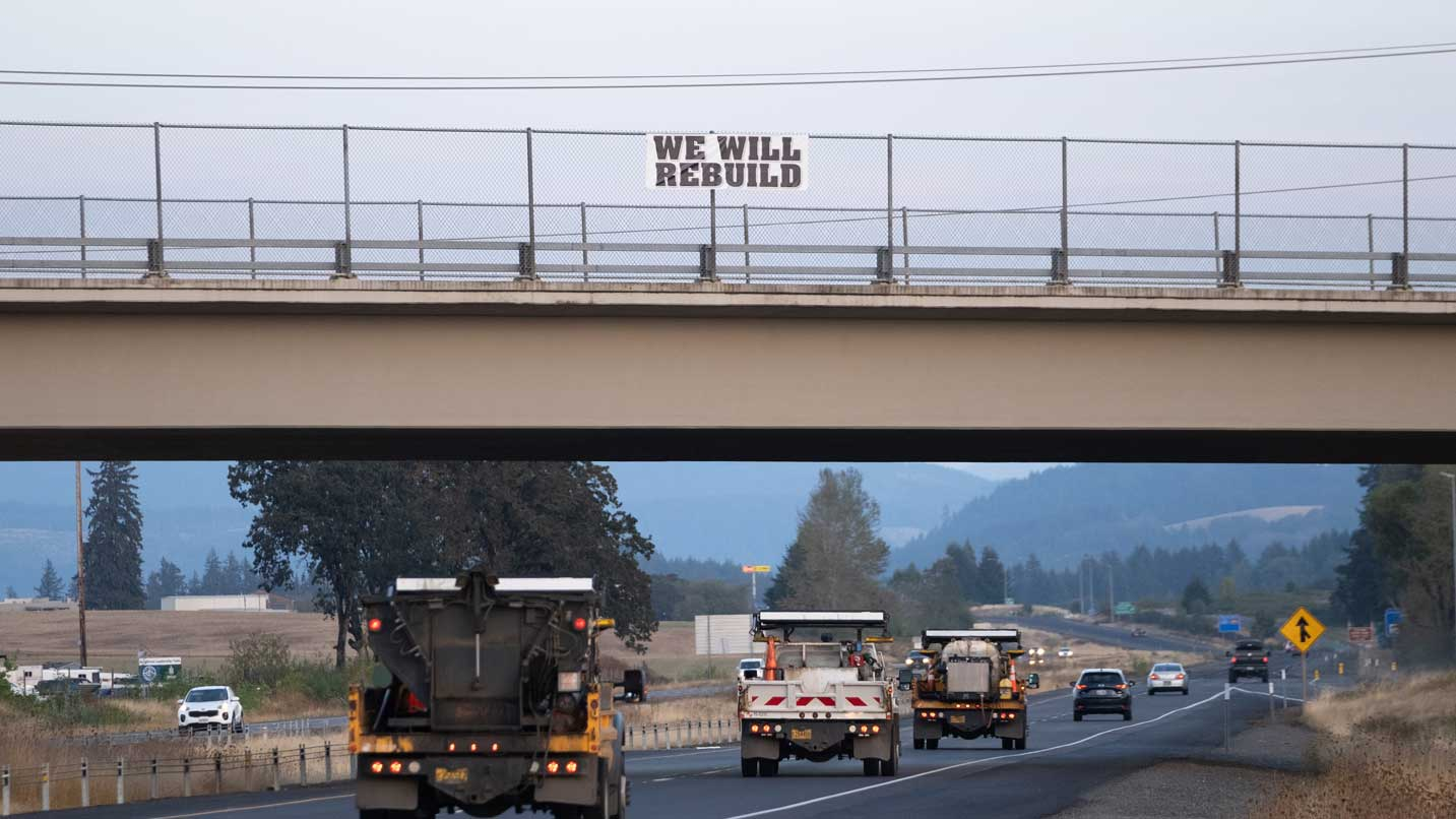 WE WILL REBUILD sign erected on highway 22 overpass just outside Stayton, Oregon.