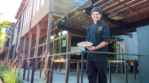 Snowboarder and mountain biker Jesse Romero has been cooking for 25 years. Now executive chef at Solstice Wood Fire Pizza Cafe & Bar in Hood River, he works on the frontline to help keep the restaurant afloat. (Photo by Susan Seubert)