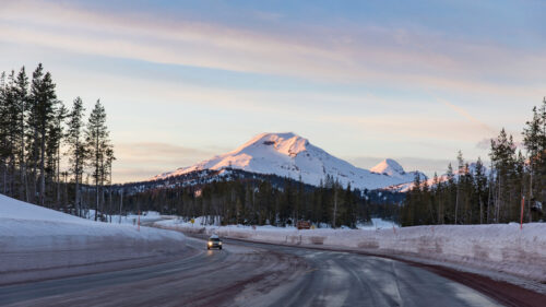 Snow surrounds the road to Mt. Bachelor.