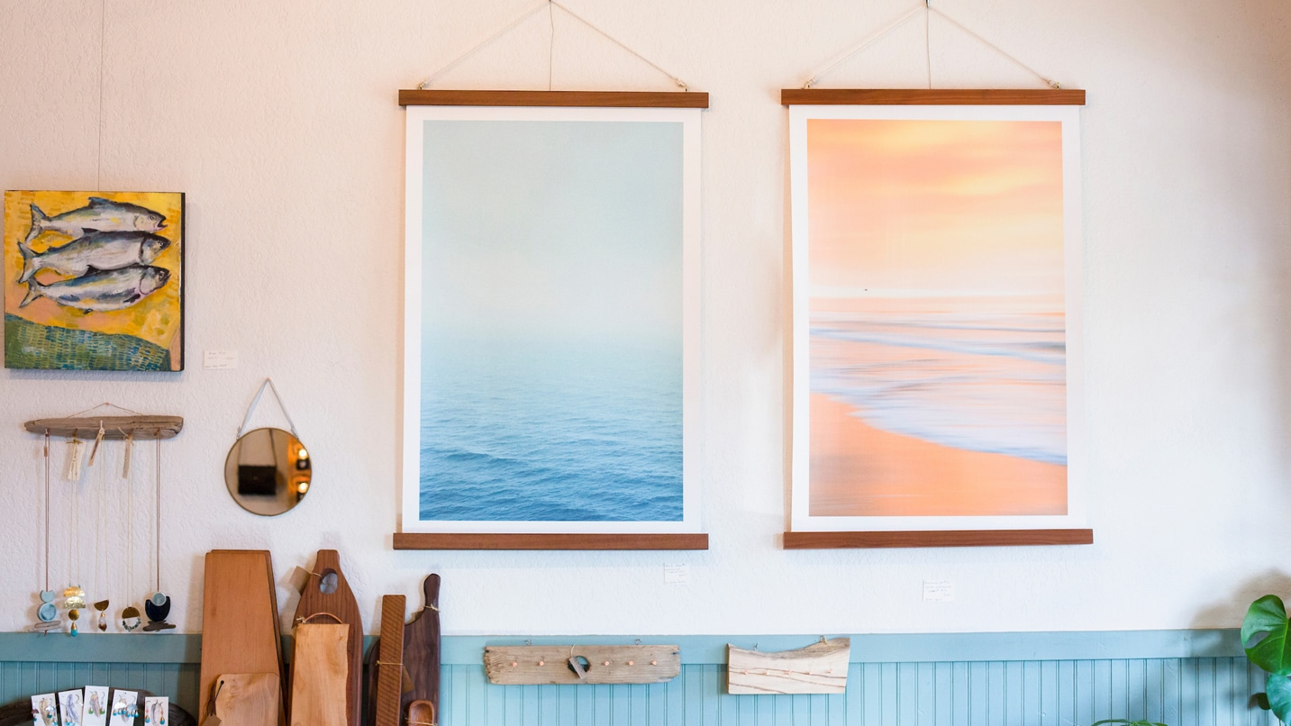 Pastel painting hangs on a wall.