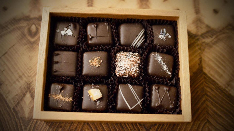 Small box containing twelve chocolates.