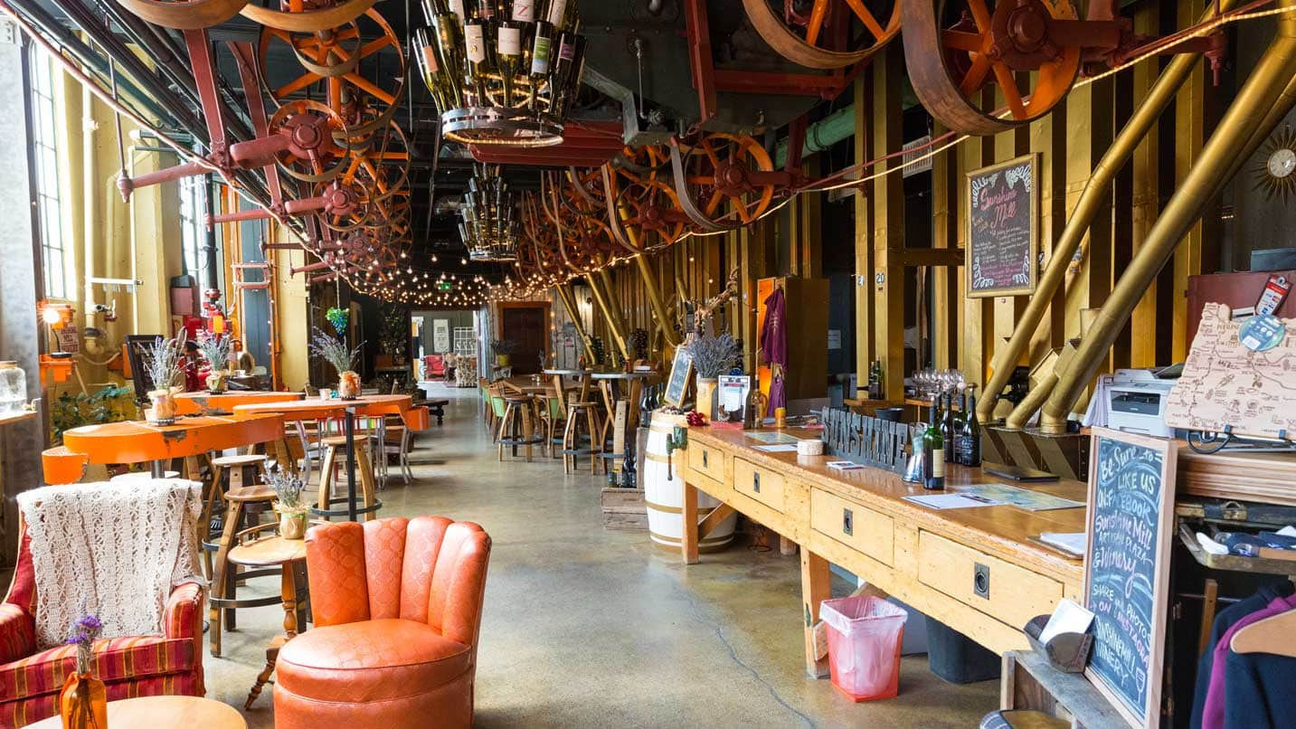 Quirky chairs and hanging decorations are displayed in a converted warehouse.
