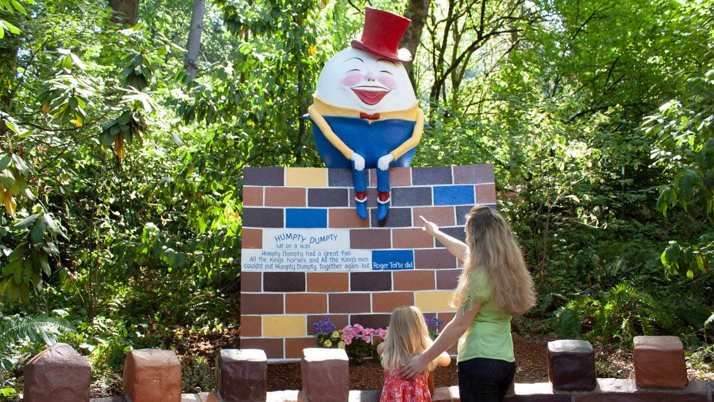 A mother and daughter look at a Humpty Dumpty display.