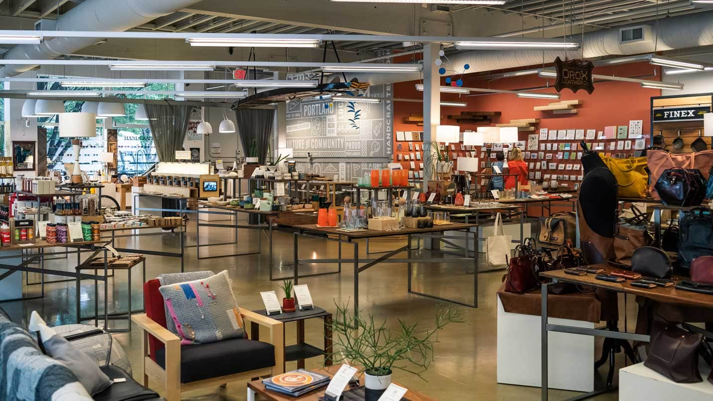 A large room showcases different crafts, from jewelry to furniture.