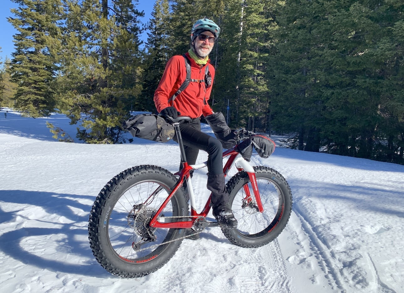 Gary Meyer poses with his fat bike in the snow.