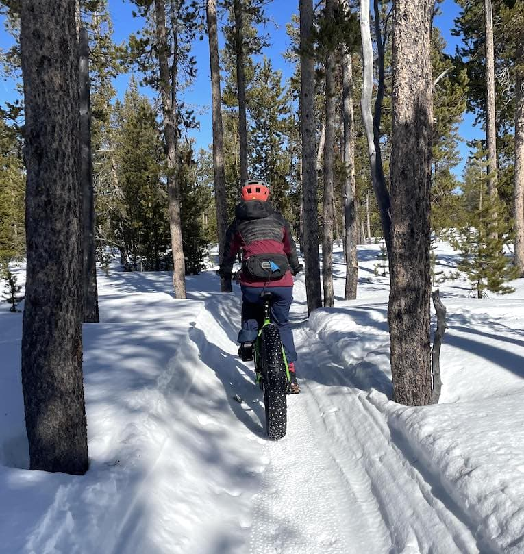 Annie Fast pedals on a fat bike.
