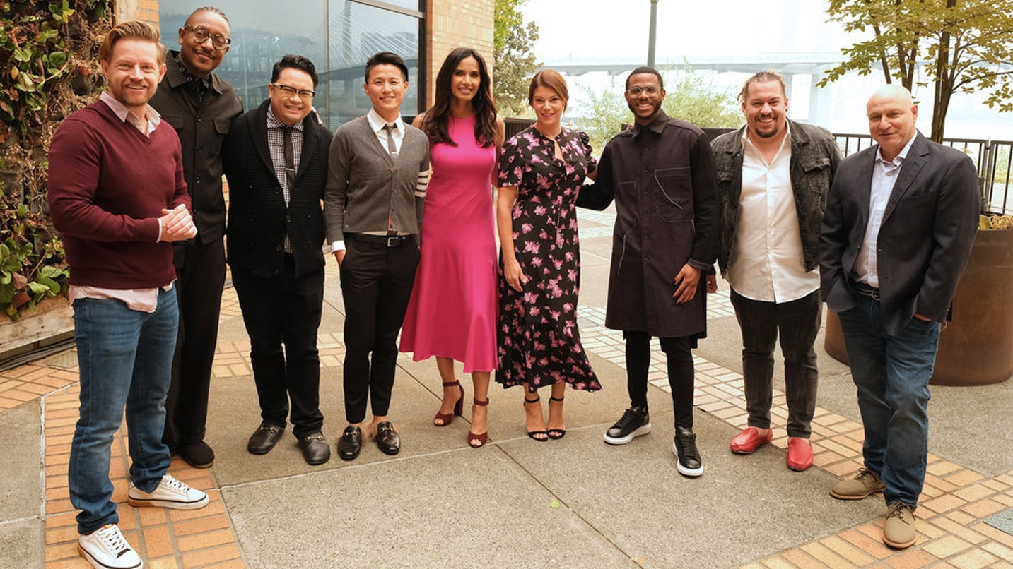 """The judges of """"Top Chef"""" stand smiling for the camera."""