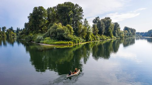 Two people in a canoe float down the river