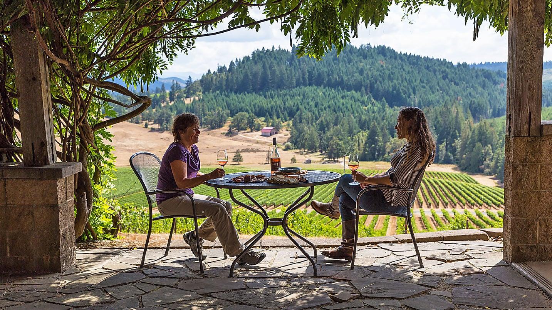 Friends drinking wine outside