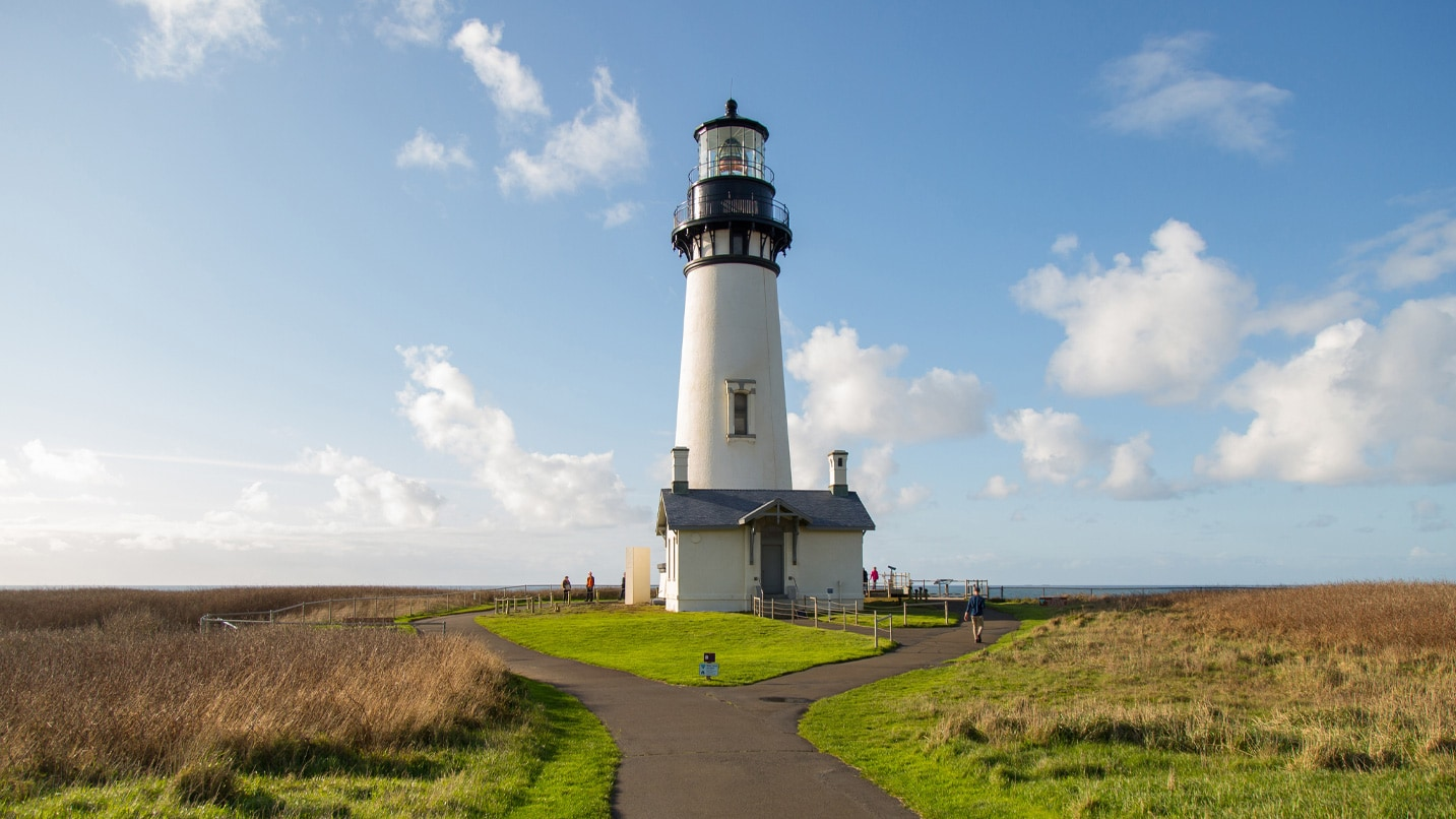A scenic vista with a lighthouse