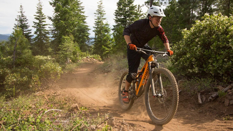A mountain biker on a dusty trail