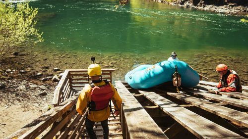 Rafters get ready to embark on a raft on the Clackamas River.