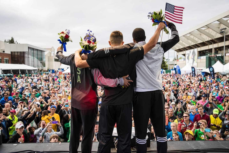 A crowd cheers on medal winners.