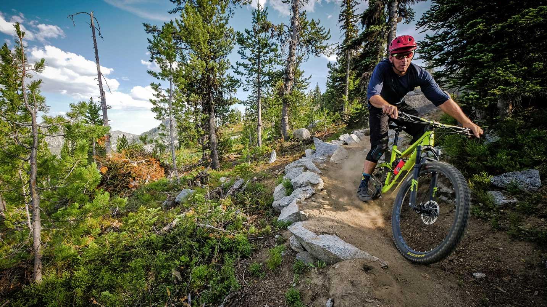 A mountain biker maneuvers a corner.