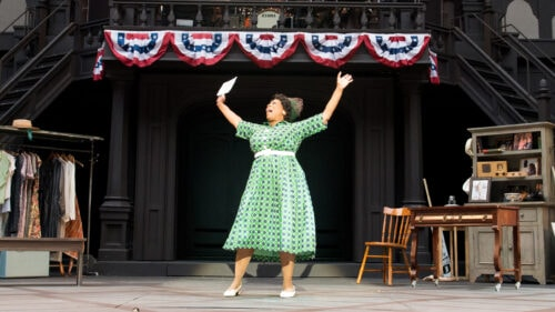 A woman performs on an outdoor stage
