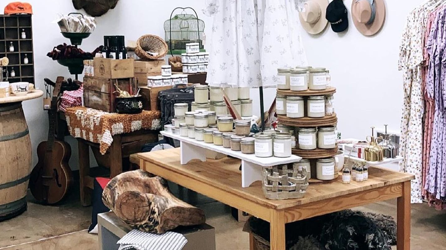 Farm style candles, clothing and home goods in a quiant shop