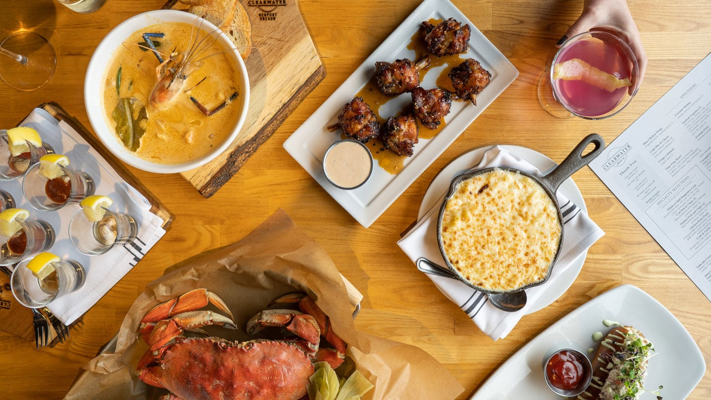 Aerial view of a seafood smorgasboard, including fresh crab and seafood soup.