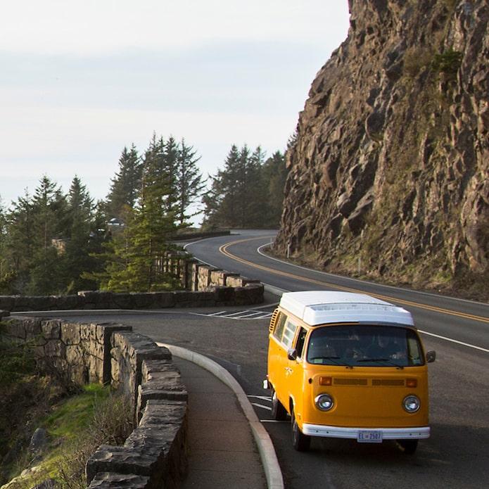 Yellow van driving along coastal highway 101