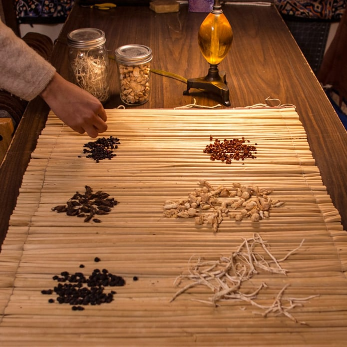 First foods, mainly roots, displayed on a table.