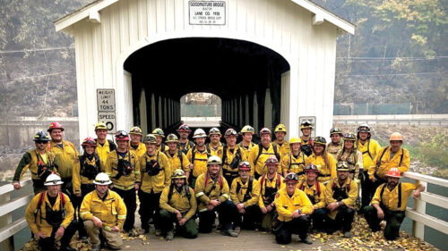 Lane County Task Force 34 and 35 in front of the Goodpasture Bridge (Photo courtesy of Lane Authority Engineer/Paramedic Matt Seckler)