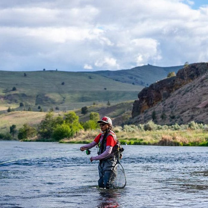 Indigenous person flyfishing in the Deschutes River