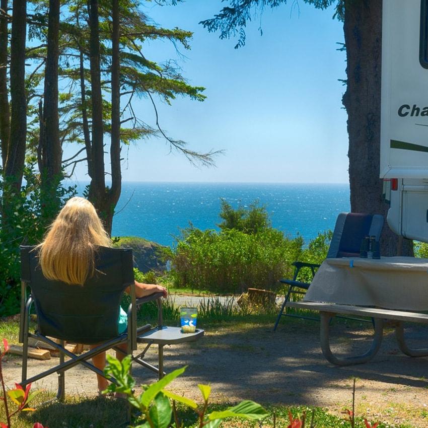 Person camping along a coastal vista