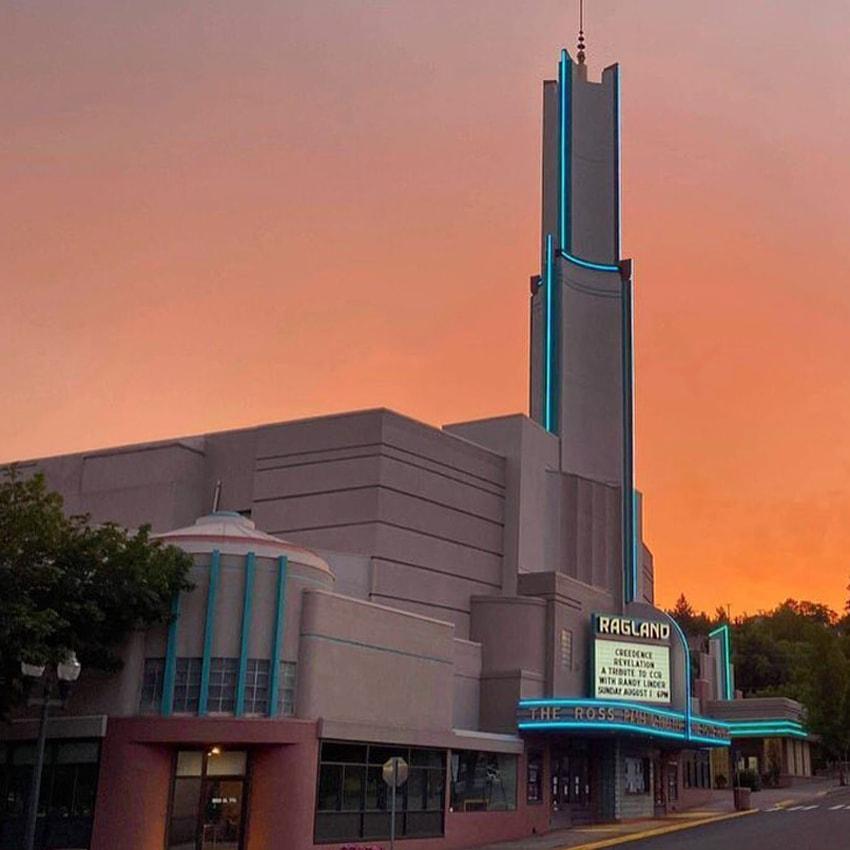 Raglund Theater with bright orange sunset in background
